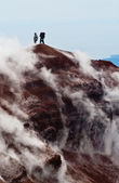 Tourists on the top of volcano. Kamchatka — Stock Photo