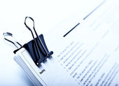 Binder clip and stack of document — Stockfoto