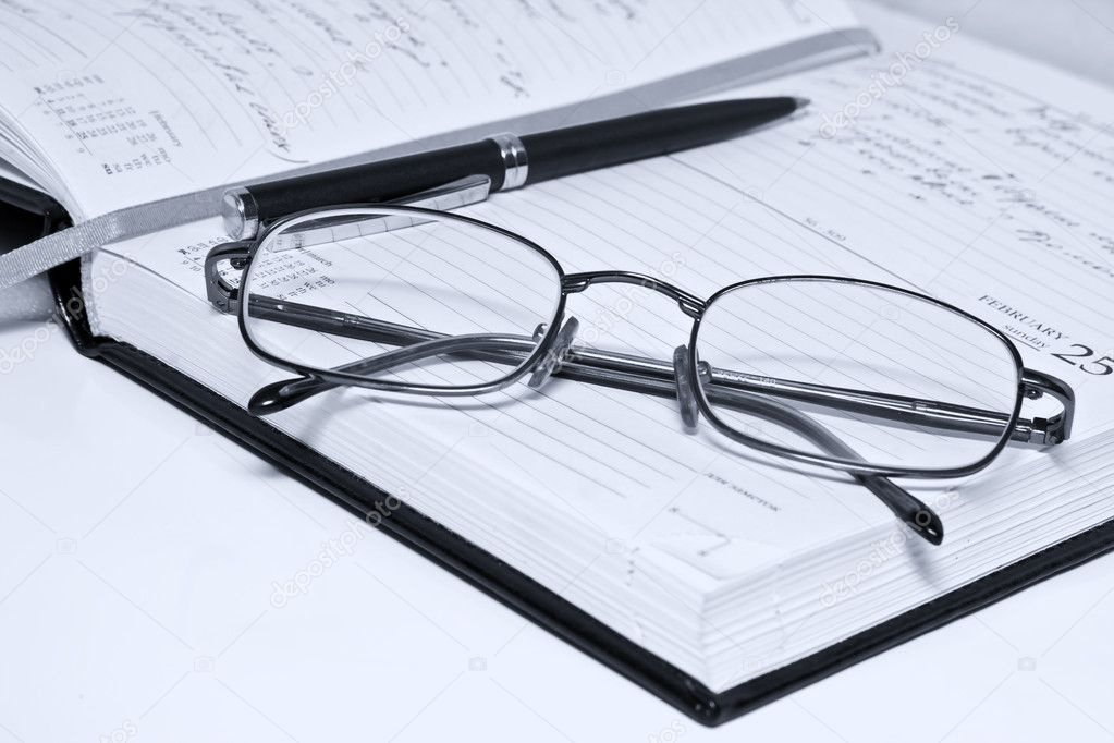 Pen glasses and notebook in composition in blue tone — Stock Photo #4163002