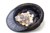 Coins in old cap — Stock Photo