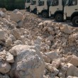 Piles of gravel and trucks — Stock Photo