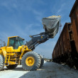 Excavator loads gravel - Stock Photo
