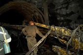 Miner works in a mine — Stock Photo