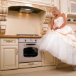 Attractive bride sitting in the kitchen — Stock Photo