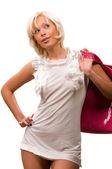 Beautiful young woman with a pink handbag — Stock Photo