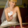 Happy bride playing cards — Stock Photo