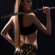 Beautiful woman with a sword in the studio — Stock Photo