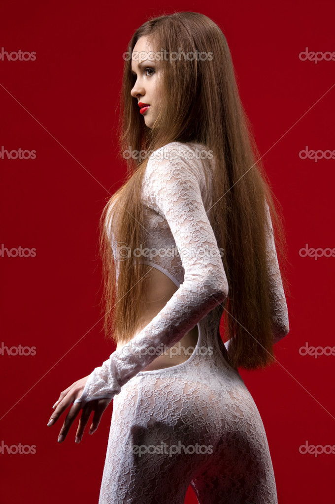 Woman in erotic clothing against red wall — Stock Photo #4240970