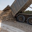 Truck unloads gravel — Stock Photo