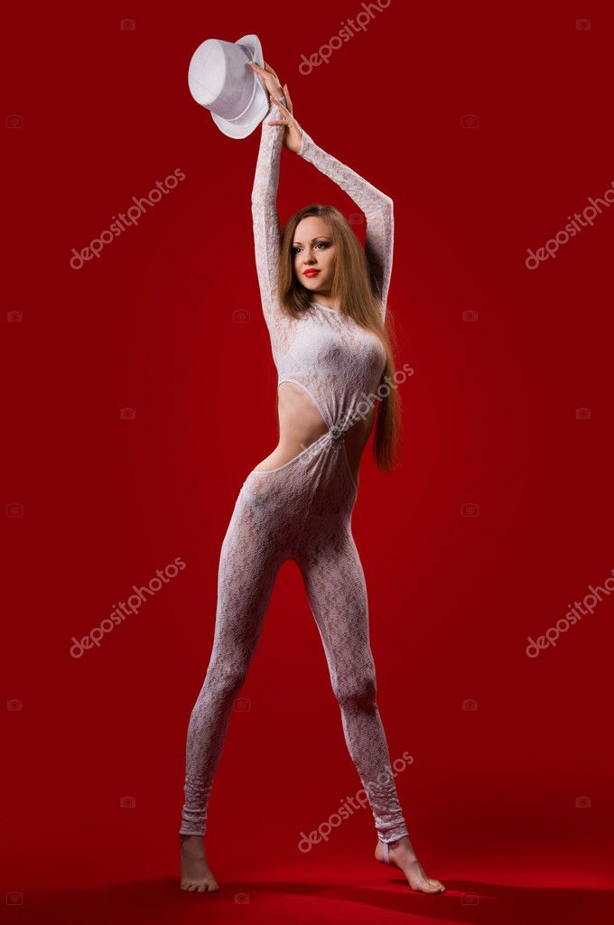 Beautiful young woman with a slender figure on a red background — Stock Photo #5039640