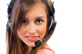 Beautiful woman with headset smiling — Stock Photo