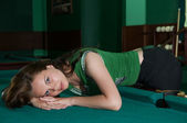 Beautiful girl lying on the table — Stock Photo