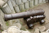 Antique gun installed in a recess of the fortress — Stock Photo
