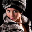 Woman in a fur hat — Stock Photo