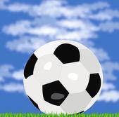 Футбольный мяч на зеленой травы — Стоковое фото