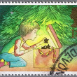A boy decorating the Christmas tree — Stock Photo
