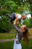 Beauty young mother with son — Stockfoto