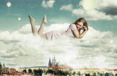 Beauty woman near the clouds — Stock Photo