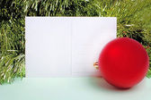 Postcard with new year ball and fir-tree — Stock Photo
