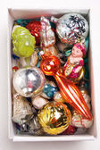 Box with antiquarian new year's toys — Stock Photo