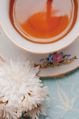 Cup of tea with flower — Stock Photo