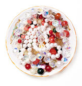 Plate with beads — Stock Photo