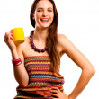 Beauty young woman with yellow cup — Stock Photo #4222227