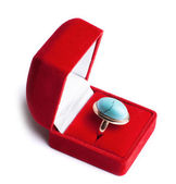 Ring with turquoise in red box — Stock Photo