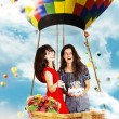 Stock Photo: Beauty girls on air balloon in sky