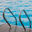 Sweeming pool steps - Stock Photo