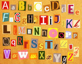 Colorful alphabet with letters torn from newspapers — Stock Photo