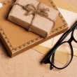 Present gift from grunge paper with glasses — Stock Photo