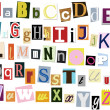 Colorful alphabet with letters torn from newspapers — Stock Photo #4716057