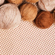 Pattern with pile of brown yarn - Stock Photo