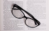 Fashion glasses on book — Stock Photo