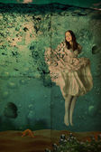 Beauty young woman in dress under water, vintage, — Stock Photo