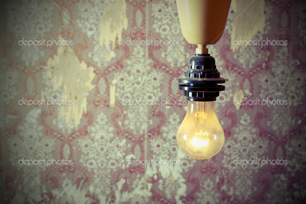 Burning lamp in the background of the old wall — Stock Photo #4441336