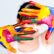 A girl with colored hands — Stock Photo