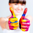 A girl with colored hands — Stock Photo #5074959