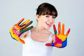 A girl with colored hands — Stock fotografie