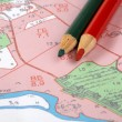 Stock Photo: Topographic map and pencils
