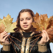 Portrait of girl with yellow leaves — Stock Photo