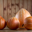 Row of pumpkins on a table — Stock Photo #4059213