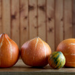 Small pumpkins on an kitchen table — Stock Photo #4175200