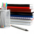 Felt-tip pens in  support and a pile of writing-books — Stock Photo