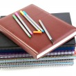 Felt-tip pen on a pile of writing-books and organizers — Stock Photo