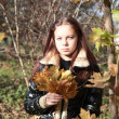 Girl-teenager with maple leaves — Stock Photo