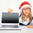 Royalty-Free Stock Photo: Businesswoman with a red Santa hat