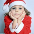 Girl in Santa's hat — Stock Photo