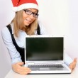 Businesswoman with a red Santa hat — Stock Photo #4598474